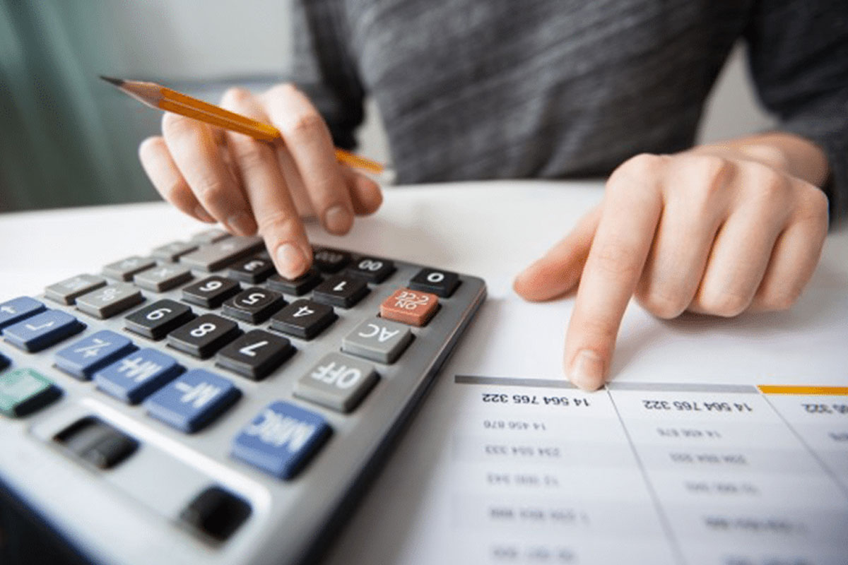 Accountant and Bookkeeper. women holding calculator and pencil
